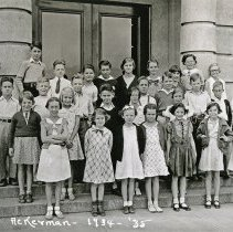 "Image of 1934-35 Ackerman Elementary 8 - ""1934-35 Ackerman, A.17.""  This is the class of 1934-35 at Ackerman Elementary School.  The picture was taken outside of the building."