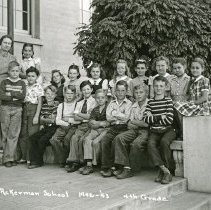 """Image of 1942-43 Ackerman Elementary 3 - """"1942-43 Ackerman School, 4th Grade, 14.""""  This is a class photo of the 1942-43 Ackerman Elementary School 4th Grade class with their teacher.  The picture was taken on the front steps of the building."""