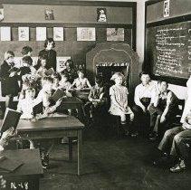 "Image of 1930 Ackerman Elementary Classroom 2 - ""[1930] Lulu Grace Allen, Teacher, 3rd grade, N-18""  This is a 1930 elementary 3rd grade classroom setting."