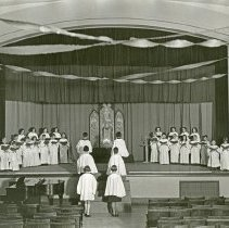 """Image of 1932 Children, Christmas Program - """"1932 Xmas Program""""  Dressed in choir robes, children practice for a Christmas singing program."""