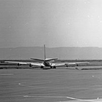 "Image of California Airport, 707 2 - ""1947 - A World Airways 707 at Oakland airport - Now 707's are banned because of excess noise"""