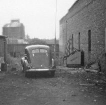Image of Automobile, Alley - An automobile is parked in a La Grande, Oregon alleyway.  [Possibly, behind Walter Reuter's Red Cross Drugstore.]
