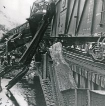 Image of Train Wreck, Bridge 1 - The wreckage of a train and twisted, steel girders of a railroad bridge after a derailment.