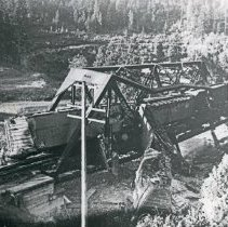 Image of Train Wreck, Bridge 4 - The wreckage of a train and twisted, steel girders of a railroad bridge after a derailment.