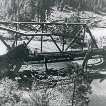 Image of Train Wreck, Bridge 5 - The wreckage of a train and twisted, steel girders of a railroad bridge after a derailment.