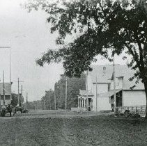 """Image of Cove, Street Scene 2 - """"Cove, Oregon street scene - circa 1910 - D. [Dunham] Wright Hotel pointed out on print.  [Dunham Wright owned the hotel, which was also called the Cove Hotel.]  Confectionery / Bakery located across the street from the hotel."""""""