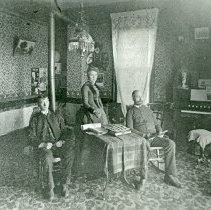 """Image of Union, Centennial Hotel Parlor - """"Union, Oregon - circa 1890.  A small family group makes use of the parlor in the Centennial Hotel."""""""