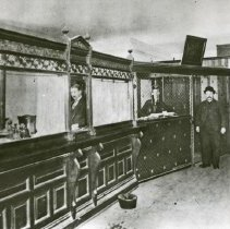 """Image of Elgin Bank, Interior - """"Elgin Bank, interior.  The first bank in the city. View of the teller's window and cage."""""""