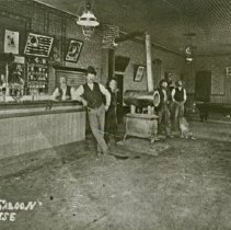 """Image of Enterprise, Corner Saloon - """"Corner Saloon interior, Enterprise, Oregon.  Bartender:  Charlie Lewis, Big man:  Albert LaTrelle.  The saloon had bullet holes in the ceiling and walls where customers had shot out the lights."""""""