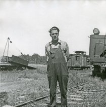 "Image of Train Engineer, Hercial Jones 2 - ""Hercial Jones - Bowman Hicks Lumber Co. yard - Maxville - 1932"""