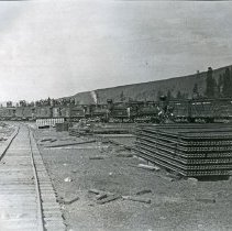 "Image of Wallowa, 1st Train - ""Monday, September 20, 1908 was a big day at Wallowa City.  The first train to ever enter the city made the run from Elgin that day and marked a milestone in the development of Wallowa County.  Up to this time people from the Wallowa valley were compelled to use Elgin as a freight and passenger terminal.  The daily train schedule to Wallowa was announced with the train to arrive at 12:20 p.m. and leave for its return trip to Elgin at 1:45 p.m.  The public was invited to bring their picnic baskets and cups (Wallowa would furnish the coffee) for the big day.  As the excursion train let off steam in the yards at Wallowa, people overflowed the cars and many men and boys stood atop the box cars.  A big celebration was held, and soon work began on the completion of the railroad to Joseph."""