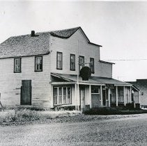 "Image of Flora, Post Office - ""Flora Post Office.  The building is closed and run down with weeds growing up around the outside.  There is an old 'Shell' sign still hanging out in front, and there is a commercial garage located to the right."""