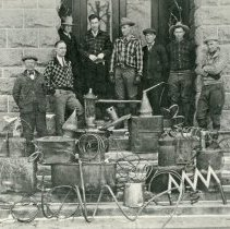"Image of Enterprise, Moonshine Still - ""Confiscated still apparatus at Enterprise, Oregon.""  [Eight unidentified men standing behind still are possibly law enforcement officers.]