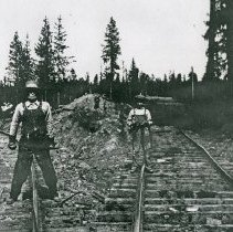 "Image of Train Tracks, Fork - ""Wye, south of Maxville where the railroad tracks split - 1923-24.  Two of the people in the photograph are identified as Mr. Lockhart, trackwalker and Mrs. Lockhart, cook."""