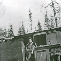 "Image of Train Fireman, Red Wilson - ""Bowman-Hicks Lumber Co. Shay #1 in Boatman Meadows, [Maxville, Oregon] - 1924.  Red Wilson, fireman, is standing in the cab.  Hercial Jones [not pictured] was the engineer."""