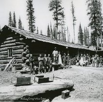 "Image of Baker, Midway Mines Camp - ""Midway Camp [Pleasant Valley, Baker County, Oregon] and Mine Crew standing in front of a log cabin - circa 1901-1903."""