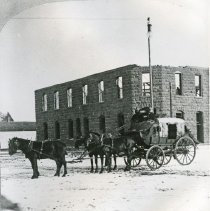 "Image of Enterprise, Street Scene 2 - ""No. 140 The Overland Mail (stagecoach pulled by a 4-horse team).  Behind the stagecoach, the Enterprise Hotel is under construction - 1902."""