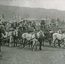 "Image of Wallowa, Freight Teams - ""Wallowa, Oregon freight teams.  In the background, view of city from east end of Main Street, looking west.  Three buildings on left:  Sherod residence, stable belonging to Holmes residence and Holmes residence - circa 1900.  The Bank, built in 1905, is not in the picture."""