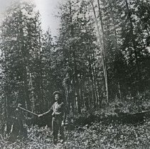 """Image of Eden, John Patterson - """"John Patterson at his cabin site in Garden of Eden, 3 1/2 miles south of Troy, Oregon.  Showing the place 'before civilization touched it' - circa 1900."""""""