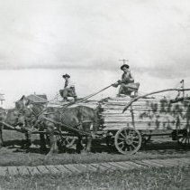 "Image of GRV, Lumber Wagons - ""'Pretty soft for Walt and Joe, with spring seats and time to visit' - early 1900's."""