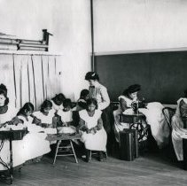 "Image of Umatilla Indian School, Sewing - ""'Umatilla Indian School, interior - Classes in domestic science [Sewing] - 1906"""