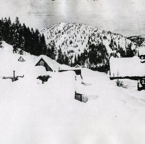 """Image of Cornucopia, Winter 1 - """"2.5.16 L.P. [Probably date and initials for photographer, Lawrence Panther.]  Feb. 5, 1916 - Postcard of Cornucopia, Ore. in winter sent by Fred Frank to Ella Frank.""""  Written on postcard:  """"Ladd's house is the one with the visible window."""""""