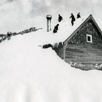 "Image of Cornucopia, Winter 4 - ""2.5.16 L.P. [Probably date and initials for photographer, Lawrence Panther.]  Feb. 5, 1916 - Cornucopia, Ore. schoolhouse in winter.""  The snow is so deep that children are playing on the roof of the building."