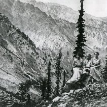 "Image of Cornucopia, Women - ""View of mountains from the Last Chance Mine near Cornucopia, Ore.  Sitting on a rock are:  Mrs. Mentle and daughter, Evangeline and Ella Frank - circa 1914."""