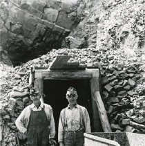 "Image of Cornucopia, Union Mine - ""William Rolfing and Fred Frank in front of a mine tunnel above the Union Mine near Cornucopia, Oregon - summer 1934."""