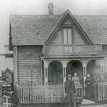 "Image of Elgin Home, Harris - ""Grandma Emaline Harris residence - 1891.  Chas Harris, Mrs. Emaline Harris, Mrs. Wheeler (Harris?).  Fme & Taylor Liveries in rear - 1897.  Evelyn Hallgarth residence - 1965."""