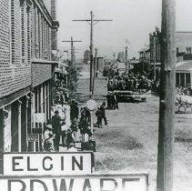 """Image of Elgin, Parade - """"Fourth of July Parade - Elgin, Oregon - July 4, 1908.  Looking north on Front St. over the 'Elgin Hardware' sign.  Directly next door to the hardware store is Dr. Easley's dentist office."""""""
