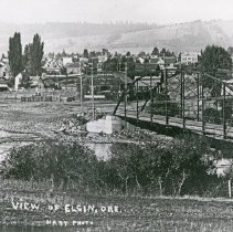 """Image of Elgin, Elevated View - """"View of Elgin, Ore. with the bridge crossing the Grande Ronde River in the foreground - circa 1910."""""""