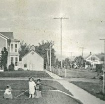 """Image of Union Home, Pursel - """"Mr. and Mrs. Pursel's home in Union, Oregon.""""  Another home, the street they live on, several yards, and three children are also pictured.  The only child who is identified is the middle child, wearing the light colored frock:  """"Bobby Mires."""""""