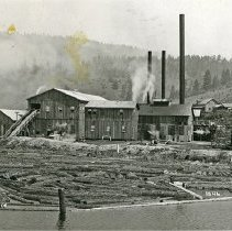 "Image of Algoma Lumber Co. Sawmill - ""1846. [Judging by the condition of the photograph and the structure of the mill and surrounding buildings, this appears to be a photograph identification #, not a year reference.]  Algoma Lumber Co. mill near Algoma, Ore."""
