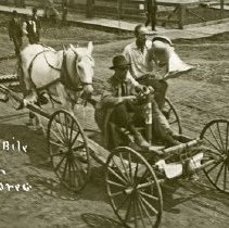 "Image of Automobile, Horse-powered - ""Automobile, Elgin, Oregon - Photo of a 'remodeled' buggy.  The buggy has been turned around and the horse is backwards in the shafts, and is pushing the buggy."""