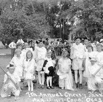 "Image of Cove, Cherry Fair 1917 1 - ""22.  7th Annual Cherry Fair - Aug. 15, 1917 - Cove, Oregon.  King Bing and Queen Ann, with Attendants.  The king is Archie Antles and the queen is Byrle Conley.  They were both about six years of age."""