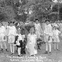 "Image of Cove, Cherry Fair 1917 2 - ""22.  7th Annual Cherry Fair - Aug. 15, 1917 - Cove, Oregon.  King Bing and Queen Ann, with Attendants.  The king is Archie Antles and the queen is Byrle Conley.  They were both about six years of age."""