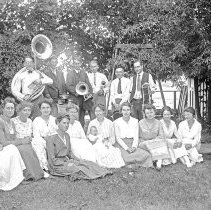 "Image of Cove, Cherry Fair Group - ""Cherry Fair - circa 1917 - Cove, Oregon.  A posed group consisting of six men, eleven women, and one baby.  The men are holding musical instruments, and 'S.A.CO.' [Salvation Army Company?] is written on their hats."""