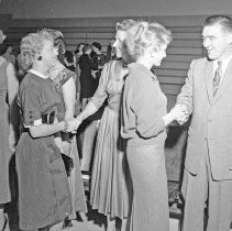"Image of 50's Employees, Reception 2 - ""Faculty Reception""  The gentleman on the right greeting women as they pass by, appears to be Professor Carlos Easley."