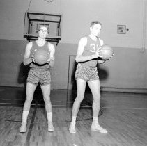 """Image of 1958-59 Basketball Players 1 - """"1958-59 Basketball""""  The image has been cropped into two individual pictures.  On the left:  Ellis Hudspeth, """"guard position - transfer from CA.""""  On the right:  Jerry Baxter - #31.  [Both photos appear in the 1959 Mountaineer yearbook - Hudspeth's on pg. 111, Baxter's on pg. 108.]"""