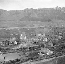"Image of Cove, Hilltop View 7 - ""Cove, Oregon - circa 1912""  Cove School can be seen in the direct center of the image, and Mt. Fanny is visible in the background."