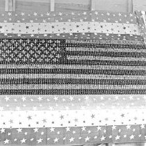 Image of Cove, Cherry Fair Display 21 - Fifth Annual Cherry Fair - 1915 - Cove, Oregon.  A cherry display designed to look like an American flag.  [Image most likely taken by photographer, Mae Stearns.]