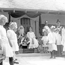 Image of Cove, Cherry Fair Entertainment 1 - Cove, Oregon Cherry Fair - circa 1920-30.  Some type of entertainment is being performed with a king and queen presiding over young girls, a bishop and a knight. [Image most likely taken by photographer, Mae Stearns.]