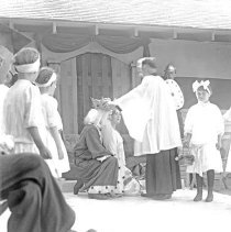 Image of Cove, Cherry Fair Entertainment 2 - Cove, Oregon Cherry Fair - circa 1920-30.  Some type of entertainment is being performed with a king and queen kneeling before a bishop while young girls and a knight look on.  [Image most likely taken by photographer, Mae Stearns.]