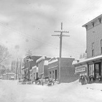 Image of Cove, Street Scene 7 - Cove, Oregon street scene in winter - circa 1905-10.  [The Forsstrom Bros. store relocated next to the Cove Hotel by 1914.]  [Image most likely taken by photographer, Mae Stearns.]