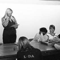 "Image of 1981 Orientation, Things to Do - ""9/22/1981 - New Student Week - Yvonne Tagge explaining ""1001 Things to Do at EOSC"" - four images"