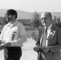 """Image of 1981 Alumni Breakfast, After 1-2 - """"10/20/1981""""  Three images of alumni socializing outdoors just after the Alumni Breakfast.  .016 - Quinn Coliseum (background)."""