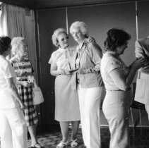 """Image of 1985 Retirement, Helen Pfel 1-2 - """"7/1985 - Helen Pfel's [or Phel, or Peel] Retirement Party"""" - ten images  .003 - Dixie Lund (left), Helen Pfel [or Phel, or Peel] (right). .005 - From left to right: Dave Gilbert (1st, background), Cleo Sorenson (3rd, foreground). .006-.007 - From left to right: Neva Neill (2nd), Cleo Sorenson (3rd), Helen Pfel [or Phel, or Peel] (4th), Myrna Edvalson (5th), Dave Gilbert (6th), Terry Edvalson (7th). .008 - From left to right: Cleo Sorenson (partial), Helen Pfel [or Phel, or Peel] (in profile), Myrna Edvalson (in profile), Dave Gilbert, Terry Edvalson (in profile). .009 - Jack Schut (right, in profile). .012-.013 - Helen Pfel [or Phel, or Peel] (foreground, 2nd in from right)."""
