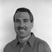 """Image of 1986 Employee, Jerry Howell - """"8/1986 - Jerry Howell""""  Three images of the head football coach."""
