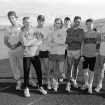"""Image of 1991 Cross Country Team 1-1 - """"2/13/1991 - Men's Track, Distance Runners""""  Those who have been identified are from left to right: Tony DeAugustine (4th), Rich Wiebe (8th)."""